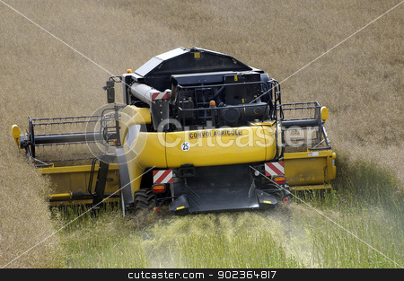 the harvest of colza stock photo, the harvest of colza with machines like a reaping-machine threshing-machine and tractor by Paire
