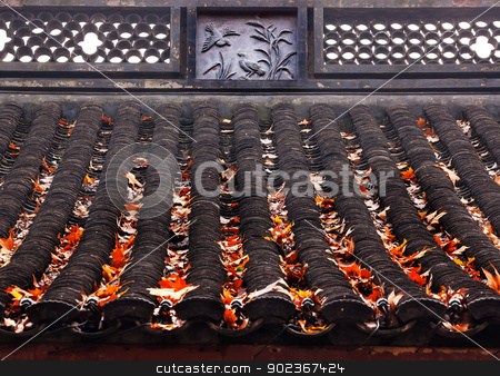 Ancient Chinese House Roof Birds Designs Autumn Leaves West Lake stock photo, Ancient Chinese House Roof Tiles Bird Designs Autumn Leaves West Lake Hangzhou Zhejiang China. by William Perry