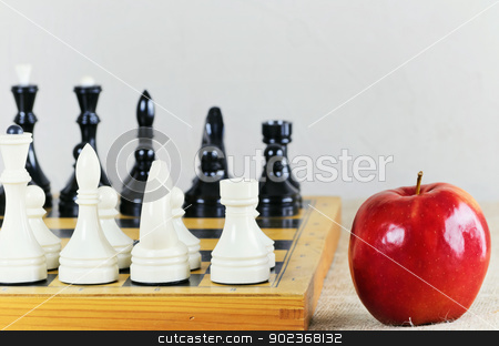 Chess stock photo, Chess On The Chess Board And Red Ripe Apple  by Sergej Razvodovskij