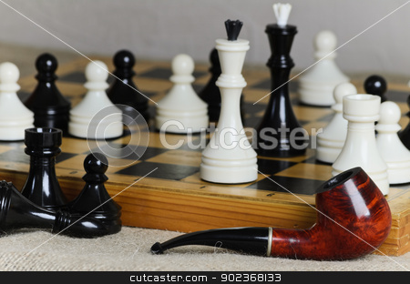 Chess stock photo, Chess middle game and tobacco pipe of one of the players by Sergej Razvodovskij