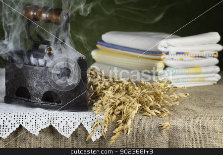 Old Hot Iron  stock photo, Old Hot Iron And Bunch Of Oats On The Table by Sergej Razvodovskij