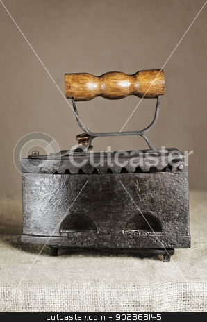 Retro Iron stock photo, Single Retro Iron On the Canvas Against Beige  by Sergej Razvodovskij