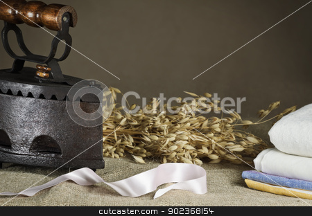 Retro Iron stock photo, Retro Iron On the Canvas Against Beige Background by Sergej Razvodovskij