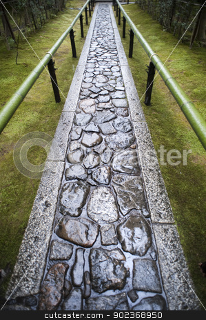 Wet footpath in Koto-in stock photo, Wet paved footpath between bamboo railings in the formal garden at Koto-in, a sub temple of Daitoku-ji in Nara , Japan by Stephen Gibson