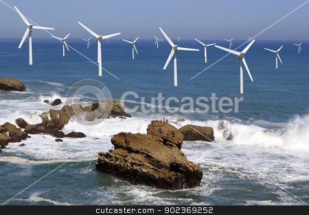 offshore wind stock photo, several offshore wind line on the horizon on cloudy sky background by Cochonneau