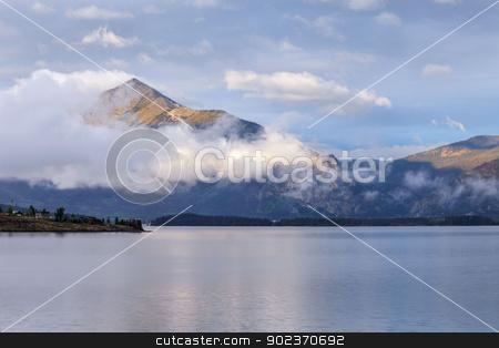 morning on Lake Dillon stock photo, morning fog rising over calm Lake Dillon in Colorado Rocky Mountains by Marek Uliasz