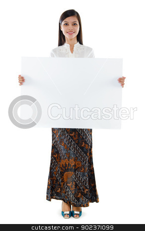 Southeast Asian woman holding a white blank card stock photo, Full body attractive Southeast Asian young woman in traditional batik kebaya costume holding a white blank card standing isolated white background. by szefei