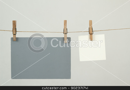 Memory note papers hanging on cord stock photo, white and grey memory note papers hanging on cord by Artush
