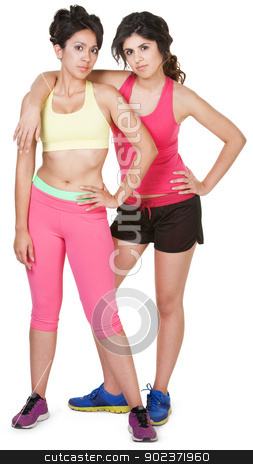 Cute Hispanic Workout Girls stock photo, Latina siblings in workout clothes on white background by Scott Griessel
