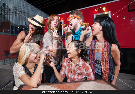 Group of Laughing People with Pizza stock photo, Six laughing people with slices of pizza outdoors by Scott Griessel