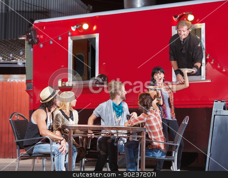 Pizza Orders from Food Truck stock photo, Smiling group with pizza orders from food truck by Scott Griessel