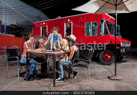 Eating Pizza Near Food Truck stock photo, Laughing friends at food truck eating pizza slices by Scott Griessel