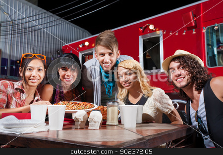 Friends Smiling Near Food Truck stock photo, Group of five adults smiling at table near mobile cafe by Scott Griessel