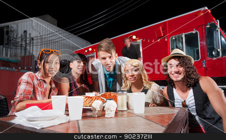 Smiling Patrons and Chef by Food Truck stock photo, Smiling patrons at table in front of chef and food truck by Scott Griessel