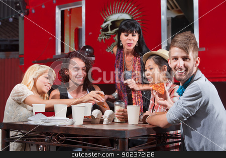 Smiling Hipster with Friends Eating stock photo, Smiling hipster with lip piercing eating pizza with friends outside by Scott Griessel