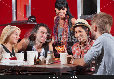 Woman Eating Pizza with Friends stock photo, Cute Asian female with hipster friends eating pizza outside by Scott Griessel
