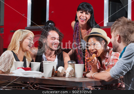 Laughing Friends Eating Pizza stock photo, Friends having fun while eating pizza outside by Scott Griessel