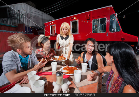 Friends Talking and Dining on Pizza stock photo, People in conversation while eating pizza from food truck by Scott Griessel