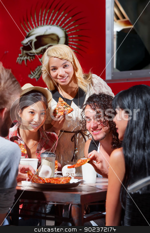 Diverse Group Eating Pizza Outside stock photo, Mixed group of happy people eating pizza outside by Scott Griessel