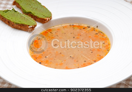 Italian minestrone soup with pesto crostini on side stock photo, classic Italian minestrone