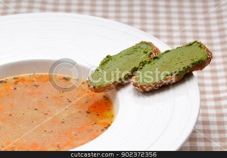 Italian minestrone soup with pesto crostini on side stock photo, classic Italian minestrone