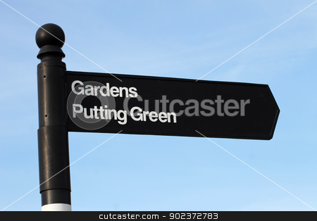 Gardens and putting green sign stock photo, Traditional English gardens and putting green sign, blue sky background. by Martin Crowdy