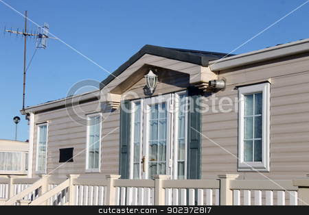 Luxurious modern caravan stock photo, Exterior of luxurious modern caravan with blue sky background. by Martin Crowdy