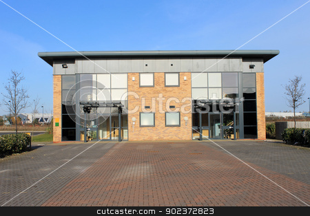 Modern office building stock photo, Exterior of large modern office building on business park. Unit is empty and available for rent. by Martin Crowdy