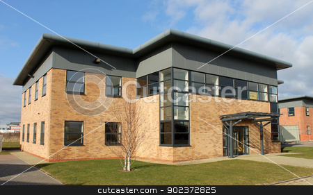 Modern office building to let stock photo, Exterior of spacious modern office building to let with sign. Empty building. by Martin Crowdy