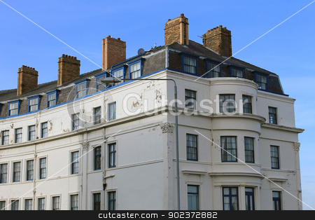 Old hotel building stock photo, Exterior of old hotel building with blue sky background. by Martin Crowdy