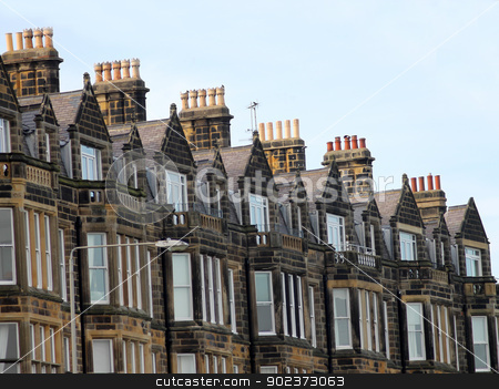 Row of old Victorian town houses stock photo, Row of old Victorian town houses on street in Scarborough, England. by Martin Crowdy
