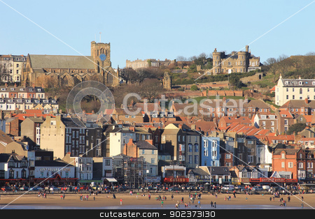 Scarborough South Bay seafront stock photo, Scarborough, North Yorkshire, England, March 02 2013: Photograph of Scarborough South Bay Beach and St Marys Church seen across the South Bay, North Yorkshire, England. by Martin Crowdy