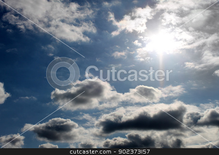 Sunshine and cloudscape stock photo, Background of sun shining in blue sky with cloudscape. by Martin Crowdy