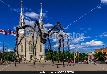 Maman spider sculpture stock photo, Maman spider sculpture on the Basilica church background, Ontario, Canada by Peter Kolomatski
