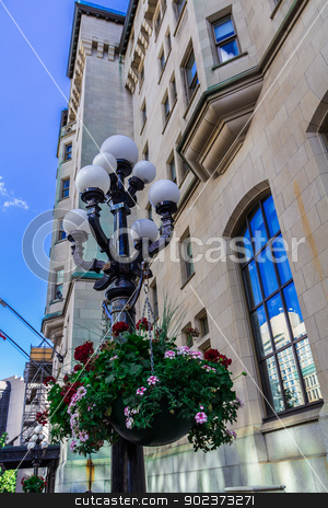 Flowers on a lamp stock photo, Flowers on a lamp in a street in Ottawa, Ontario, Canada by Peter Kolomatski