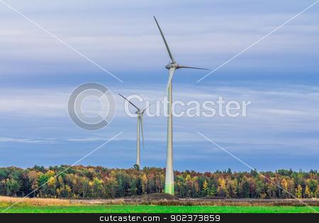 Wind turbine in a field stock photo, Wind turbine in a field in the evening, producing wind, Canada by Peter Kolomatski