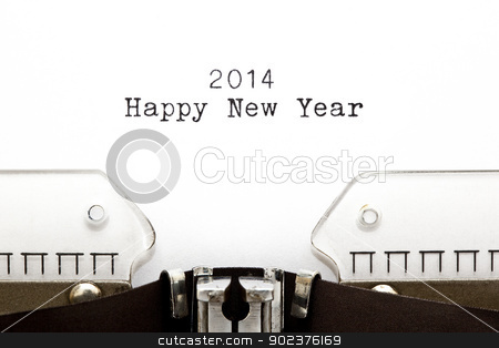 Happy New Year 2014 stock photo, Happy New Year 2014 written on an old typewriter. by Ivelin Radkov