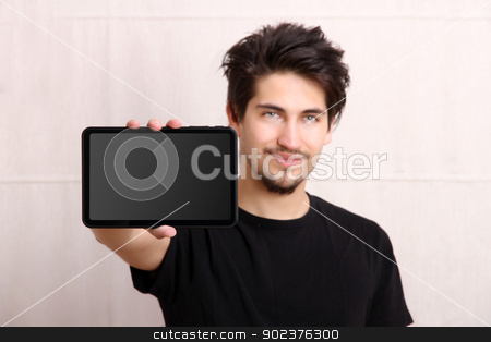 Tablet PC stock photo, A young hispanic man holding a Tablet PC. by Michael Osterrieder