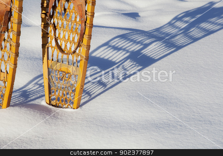 vintage Bear Paw snowshoes stock photo, shadow of vintage Bear Paw snowshoes in snow by Marek Uliasz
