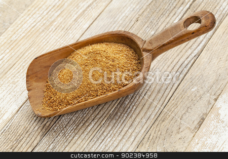 coconut palm sugar stock photo, a wooden rustic scoop of unrefined coconut palm sugar against a white painted grunge wood background by Marek Uliasz