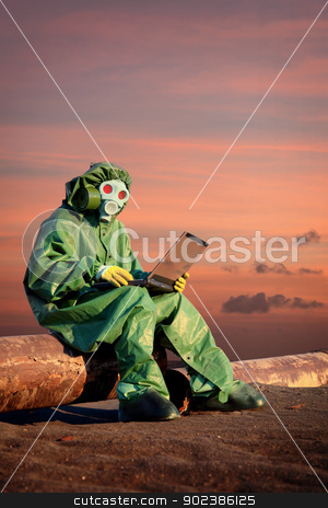 Man in protective suit works in contamination area stock photo, A man in protective suit works in the area of chemical contamination by Alexey Romanov