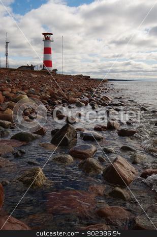 Beacon on coast of northern sea stock photo, Beacon on coast of cold northern sea by Alexey Romanov