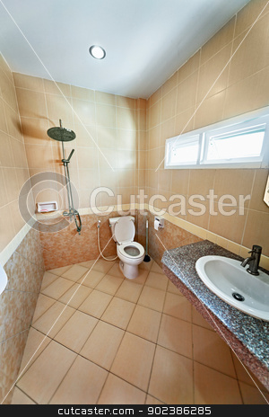 Interior of beige bathroom with shower stock photo, The interior of modern bathroom with shower. Beige tiles by Alexey Romanov