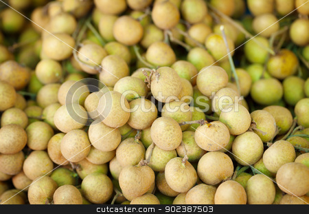 Longan fruit on the counter of the Asian market stock photo, Longan fruit close-up on the counter of the Asian market - Thailand by Alexey Romanov