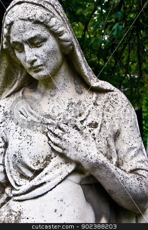 Grief stock photo, detail of an old tombstone showing a grieving woman by Juliane Jacobs