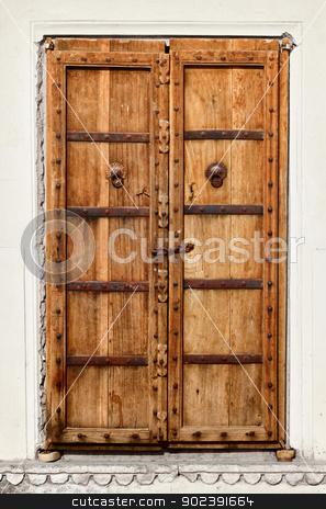 An old dilapidated wooden door stock photo, An old dilapidated wooden door of Indian home by Alexey Romanov