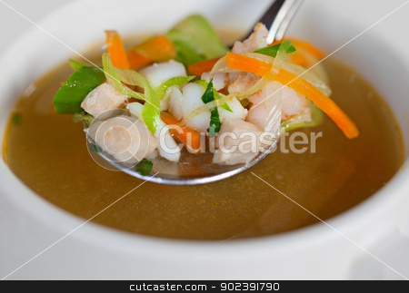 Rustic indonesian chicken soup stock photo, Rustic indonesian chicken soup in a small bowl by Alexey Romanov