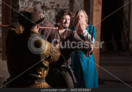 Knight Losing a Swordfight stock photo, Knight in front of lady losing sword fight  by Scott Griessel