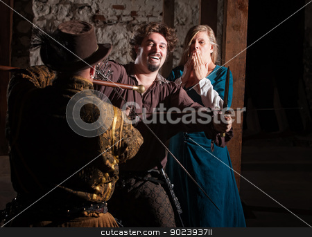 Medieval Hero Swordfighting stock photo, Laughing bearded sword fighter protecting scared woman by Scott Griessel