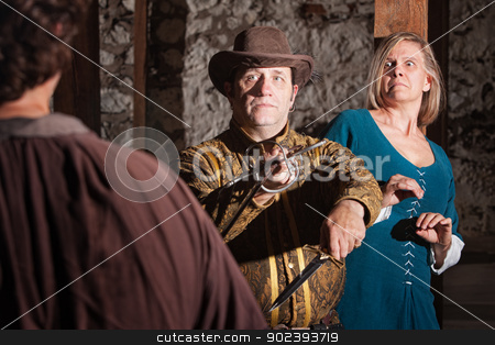 Medieval Swashbuckler Saves Woman stock photo, Brave medieval hero and lady fighting off swashbuckler by Scott Griessel